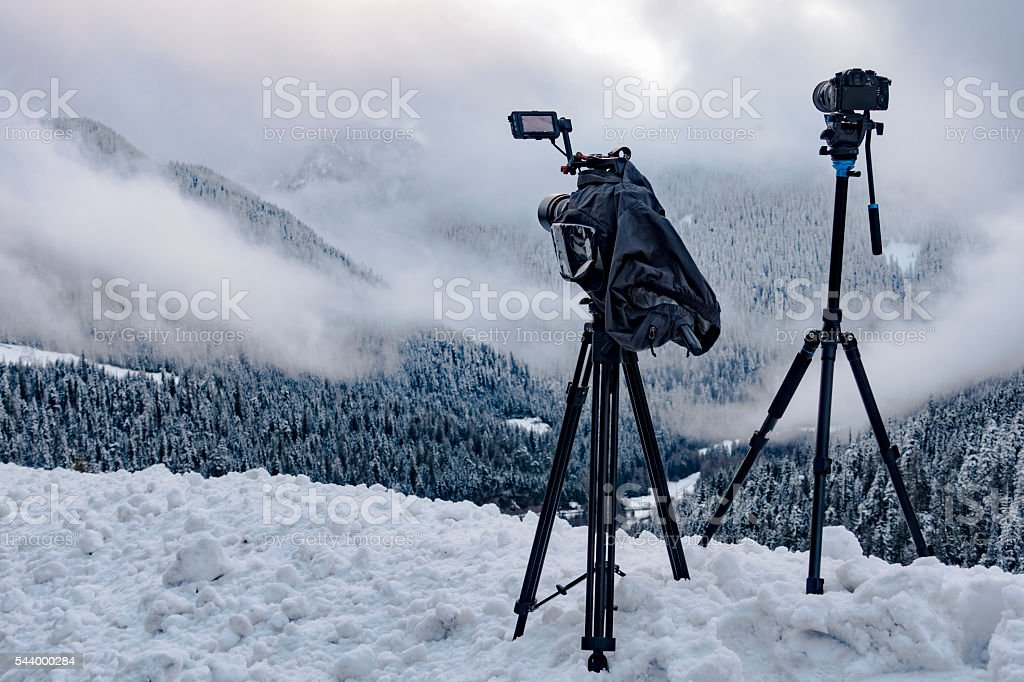 Two Cameras Shooting Timelapses of Mountain Forest Landscape in Nature stock photo