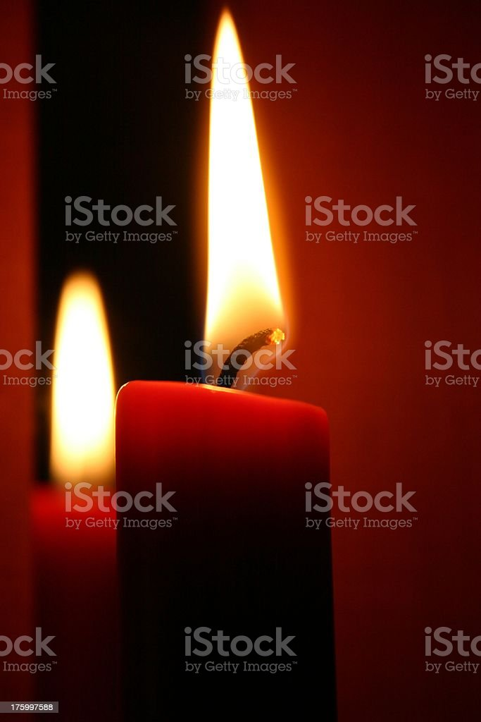 Two candles burning royalty-free stock photo