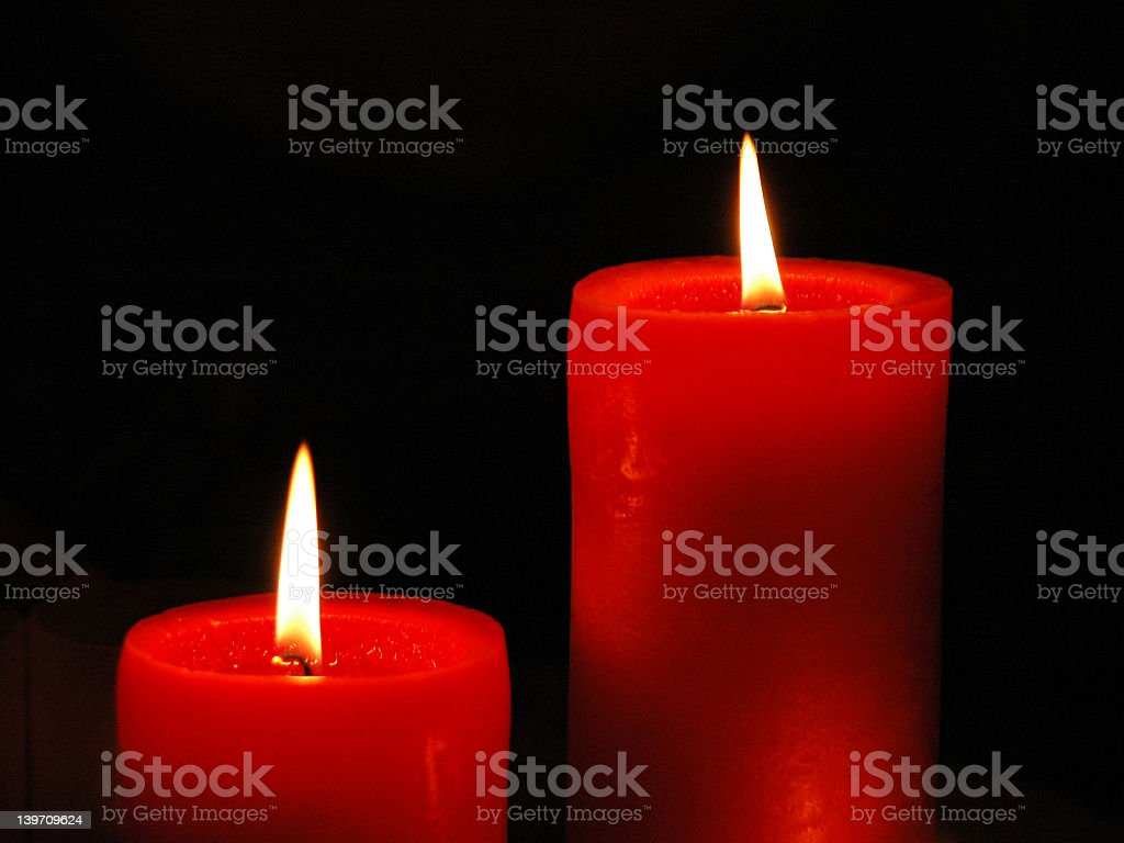 Two candles in the darkness royalty-free stock photo