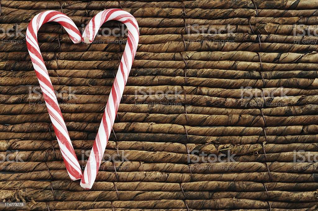 two candy canes for Christmas on reed background copyspace stock photo