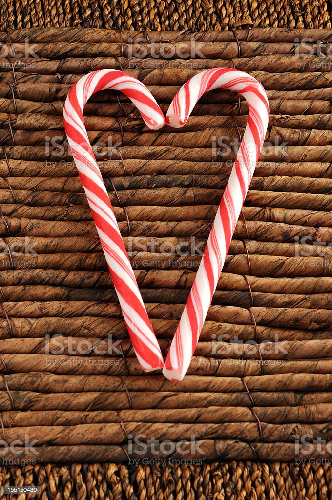 two candy canes for Christmas on reed background stock photo