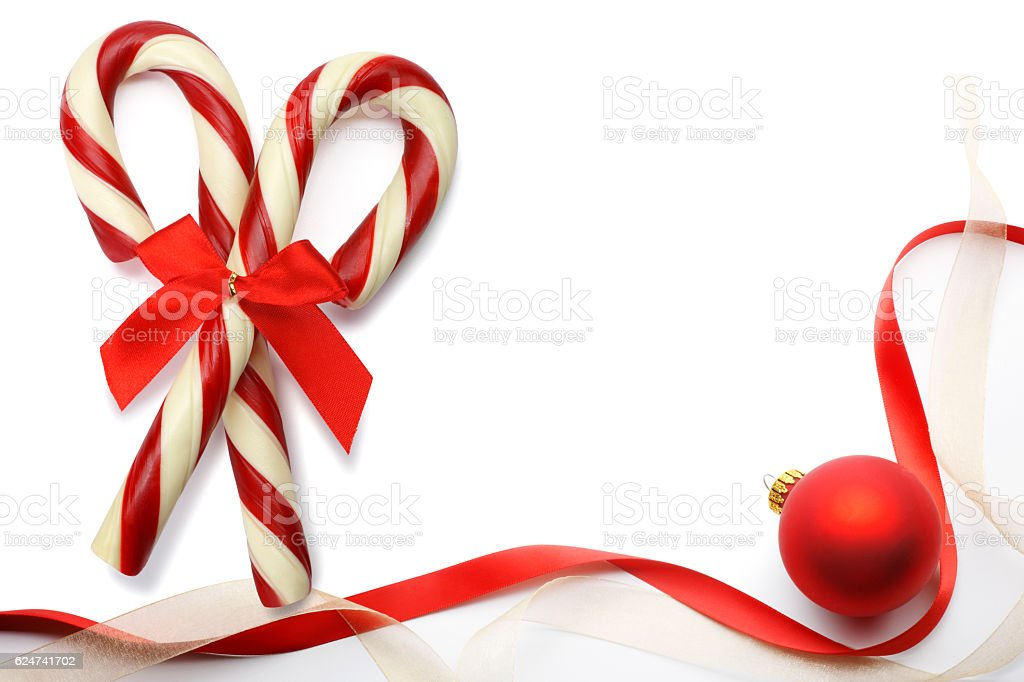Two Candy Canes Next To Twisting Ribbon And Ornament – Foto