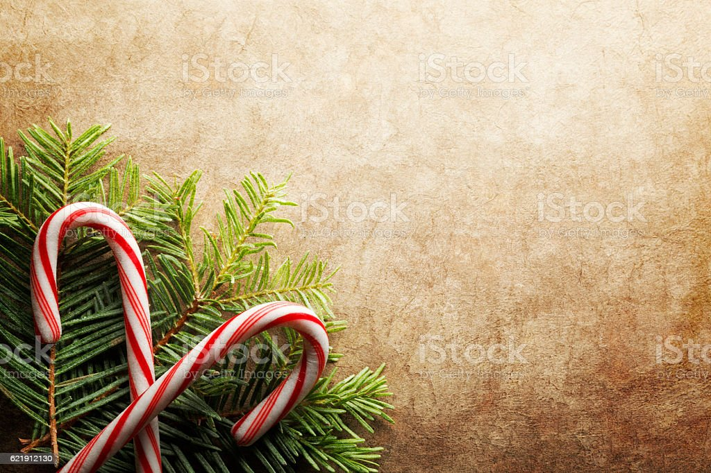 Two Candy Canes On A Small Bed Of Pine Boughs stock photo