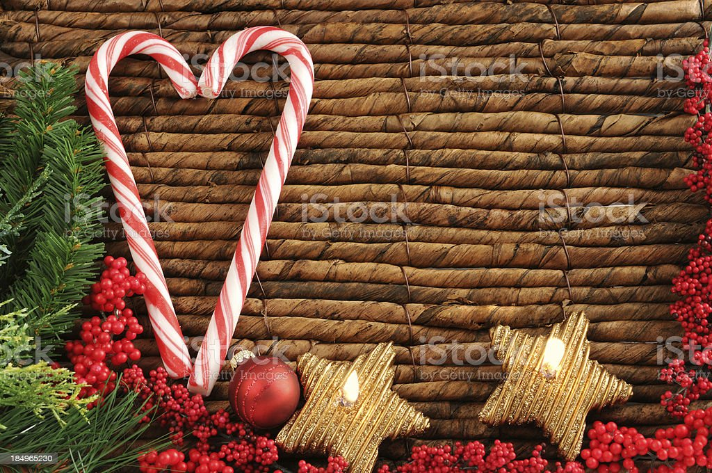 two candy canes with Christmas ornament and tea light stock photo