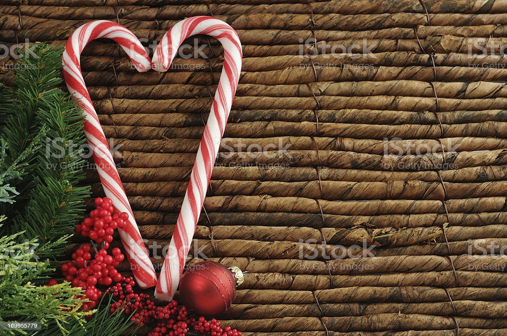 two candy canes with Christmas ornament stock photo