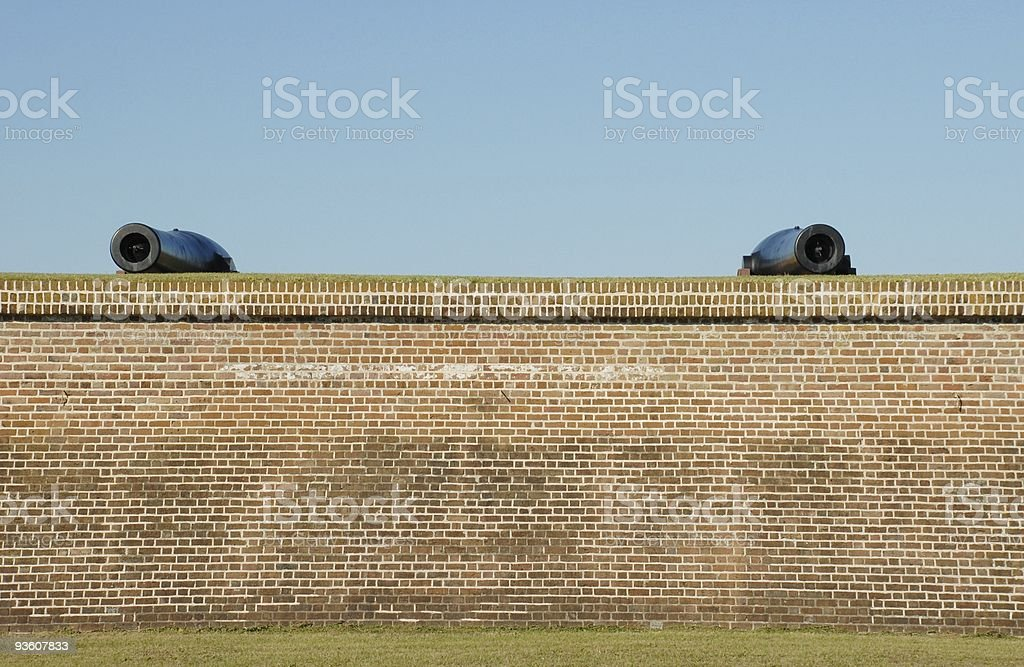Two cannons rise above the walls of Fort Moultrie royalty-free stock photo