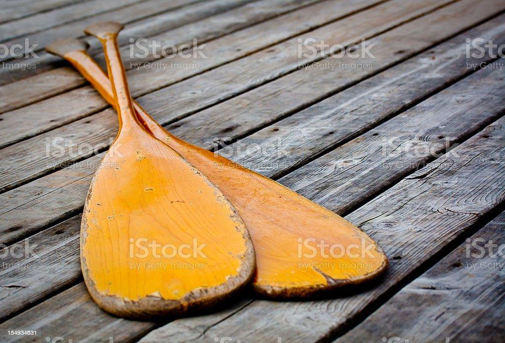 Two Canoe Paddles on Dock stock photo