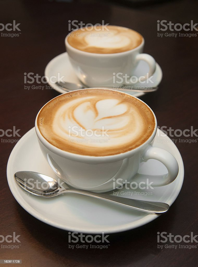 two cappuccino cups royalty-free stock photo