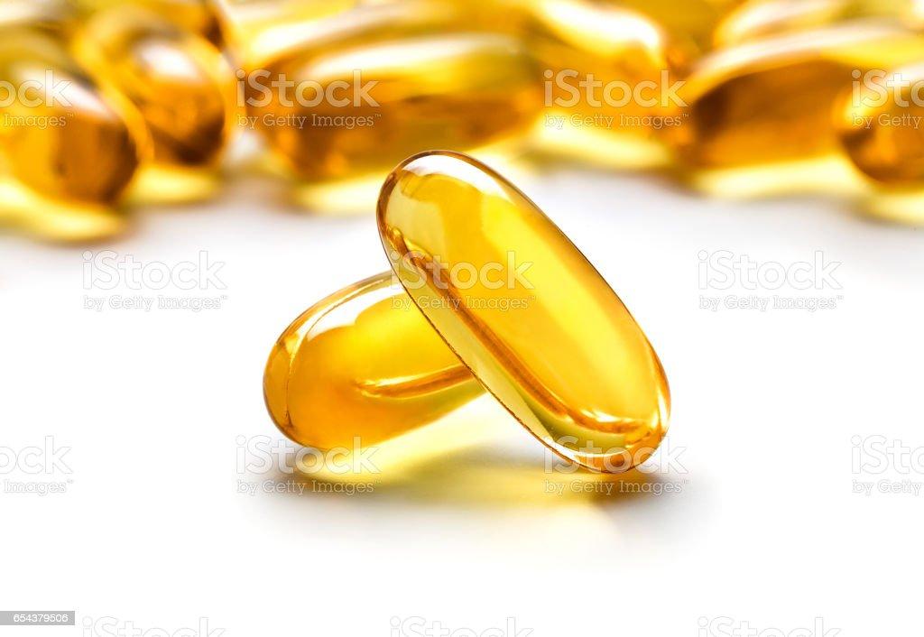 Two capsules Omega 3 isolated on white background stock photo