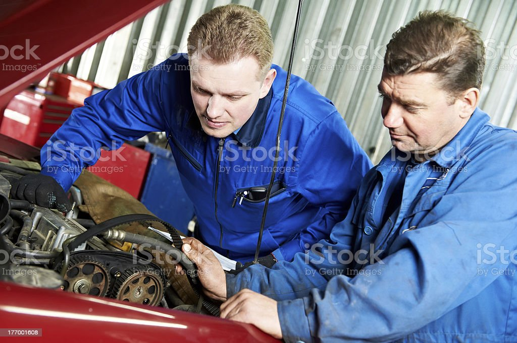 two car mechanic diagnosing auto engine problem stock photo