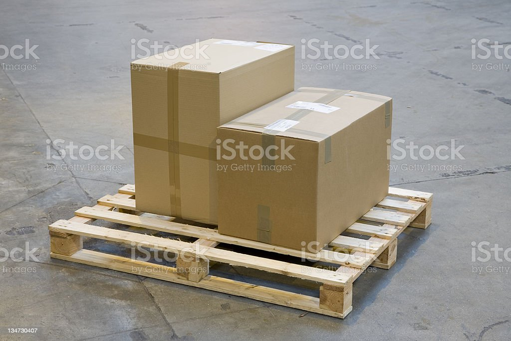 two cardboard boxes on a pallet stock photo