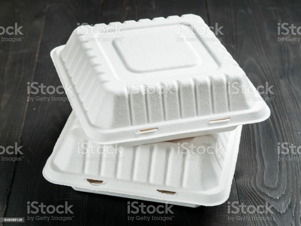 Two cardboard lunch box on wooden background stock photo