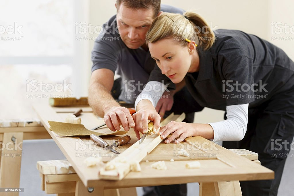 Two carpenter working together at work site stock photo