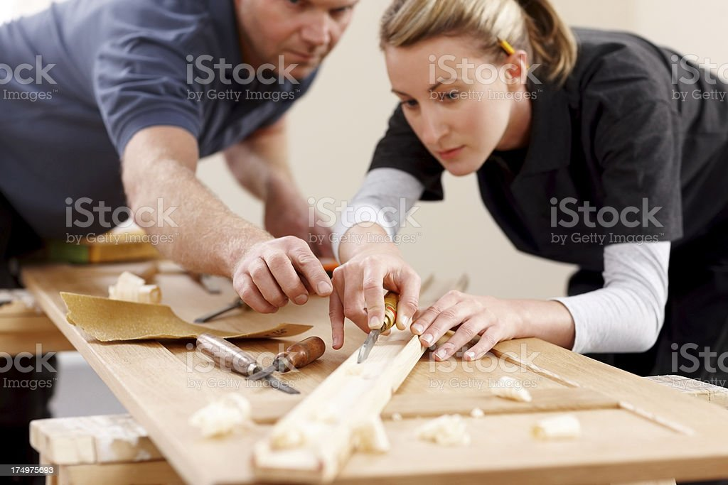 Two carpenter working with a chisel stock photo