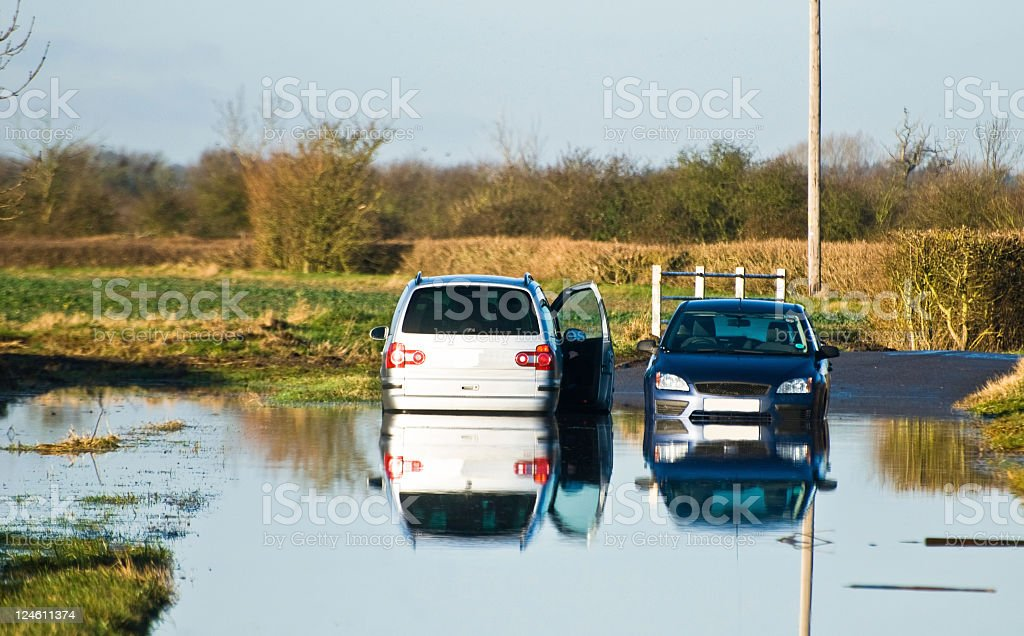 Two cars abandoned in the flood royalty-free stock photo