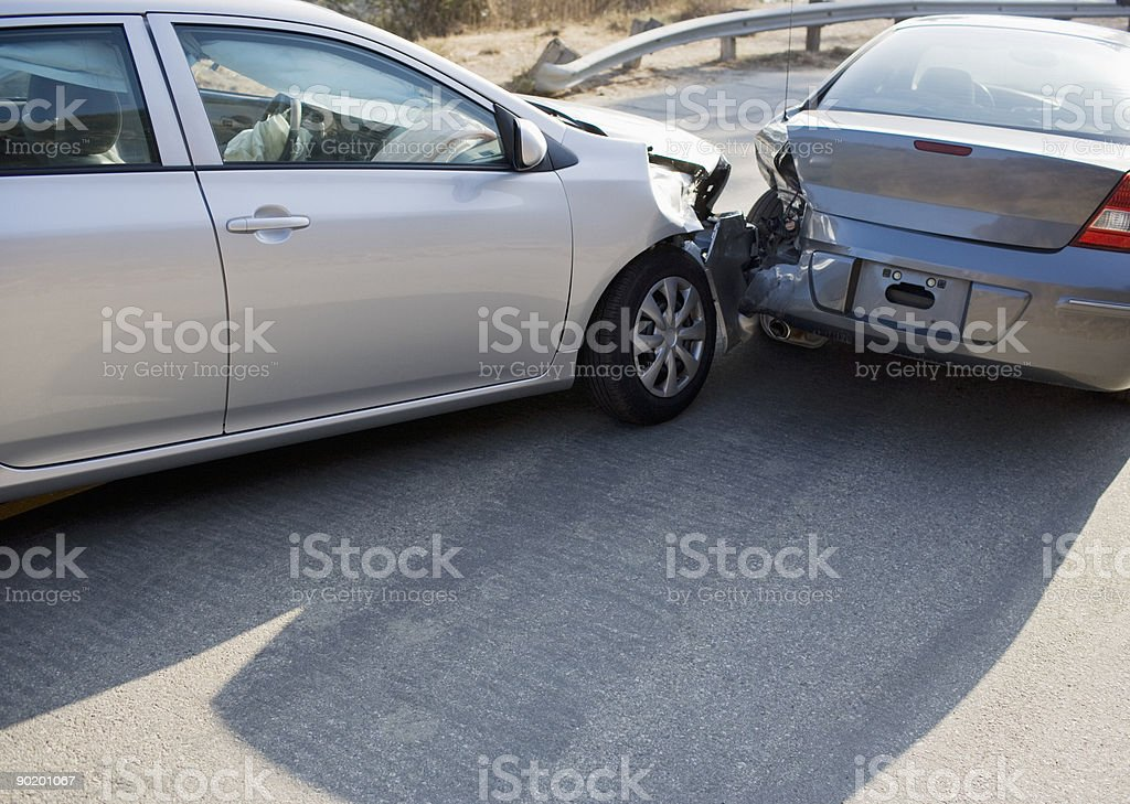 Two cars in collision on roadway stock photo