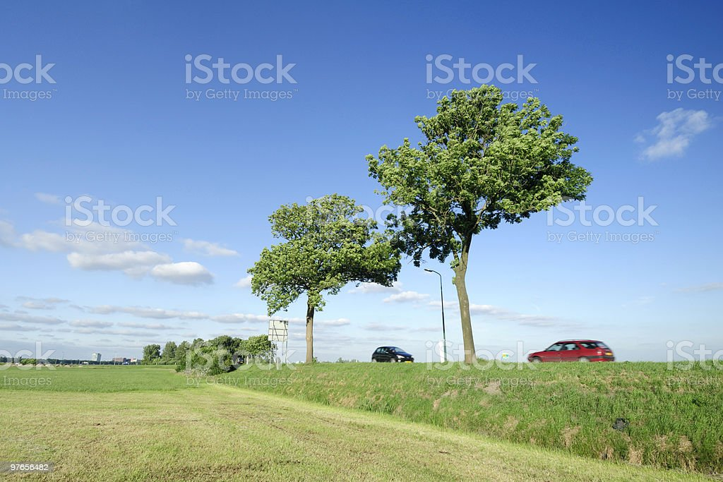 Two cars on a dyke road royalty-free stock photo