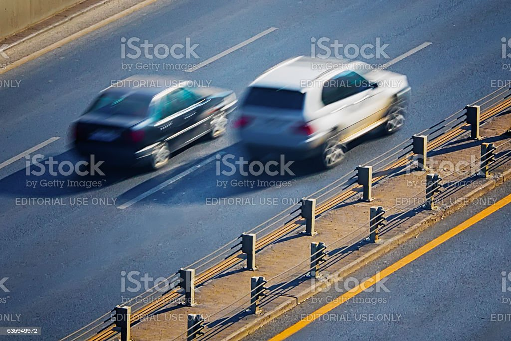 Two cars on highway stock photo