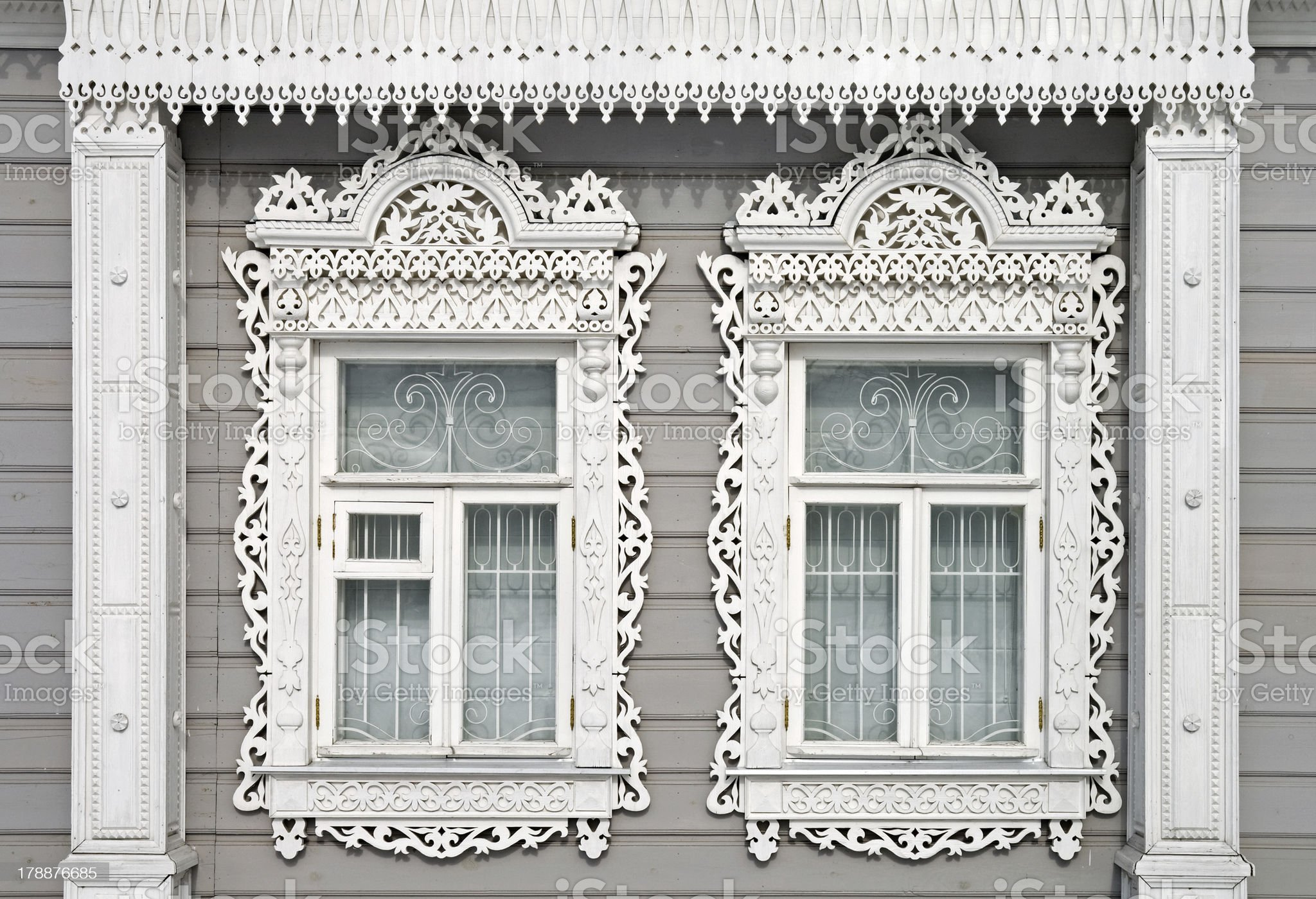 Two carved windows in Kolomna town, Russia royalty-free stock photo
