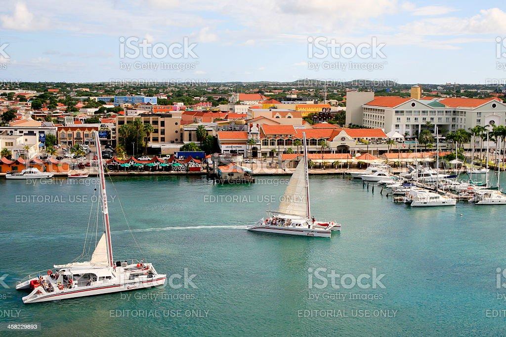 Two Catamarans Leaving the Oranjestad Inner Harbor royalty-free stock photo