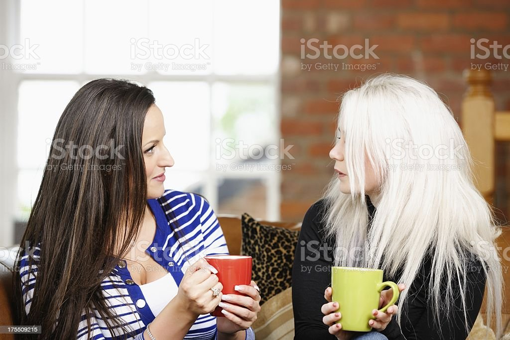 Two Caucasian Women Relaxing And Having A Chat royalty-free stock photo