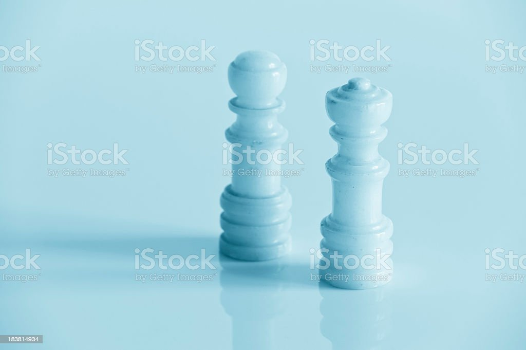 Two Ceramic Chess Pieces In Blue Tone royalty-free stock photo