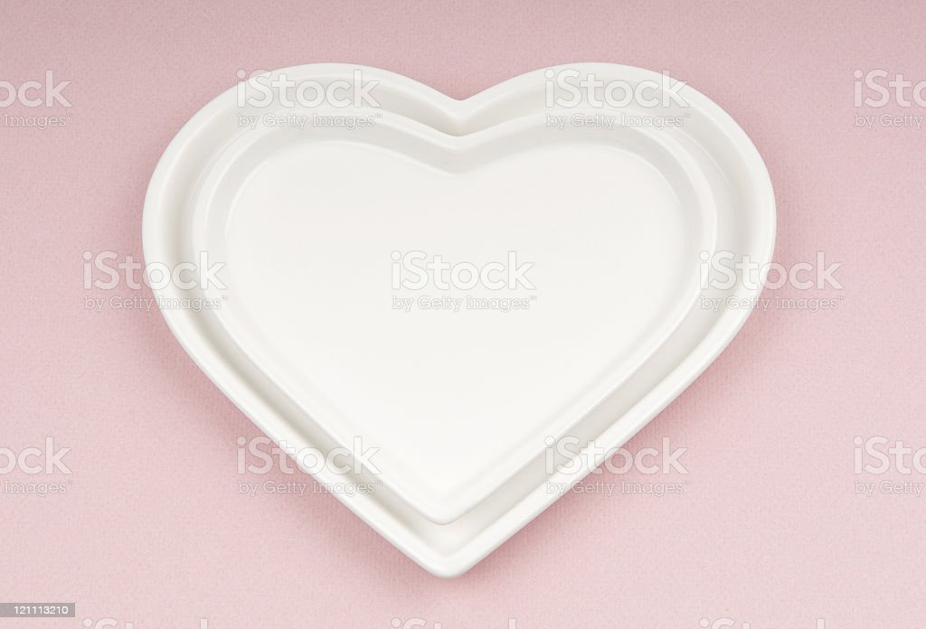Two Ceramic Hearts on Pink royalty-free stock photo