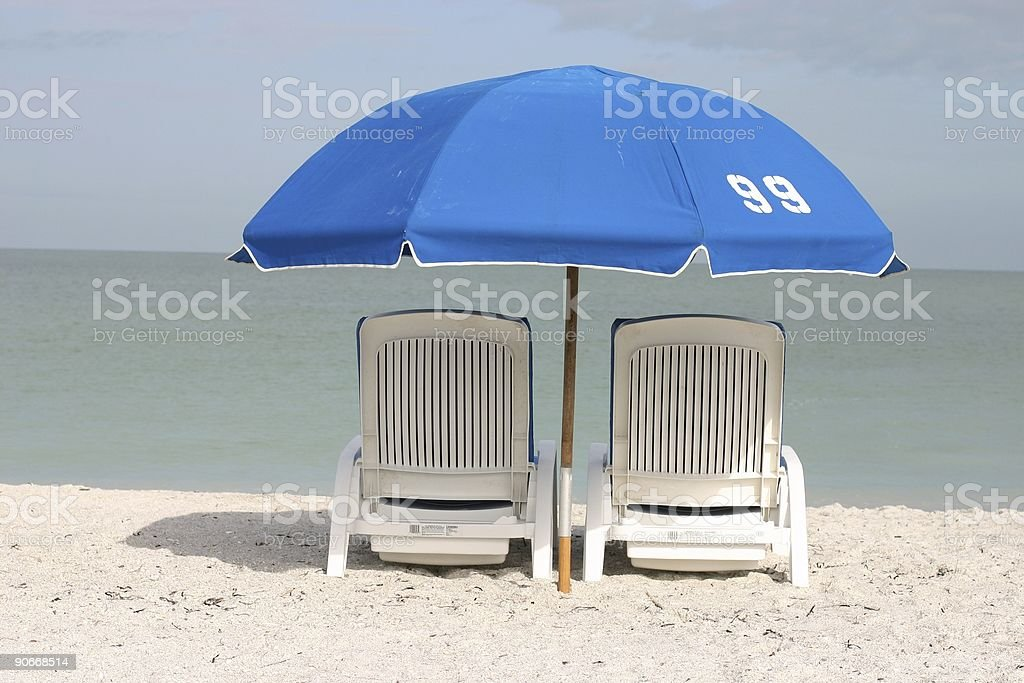 Two chairs and an umbrella royalty-free stock photo