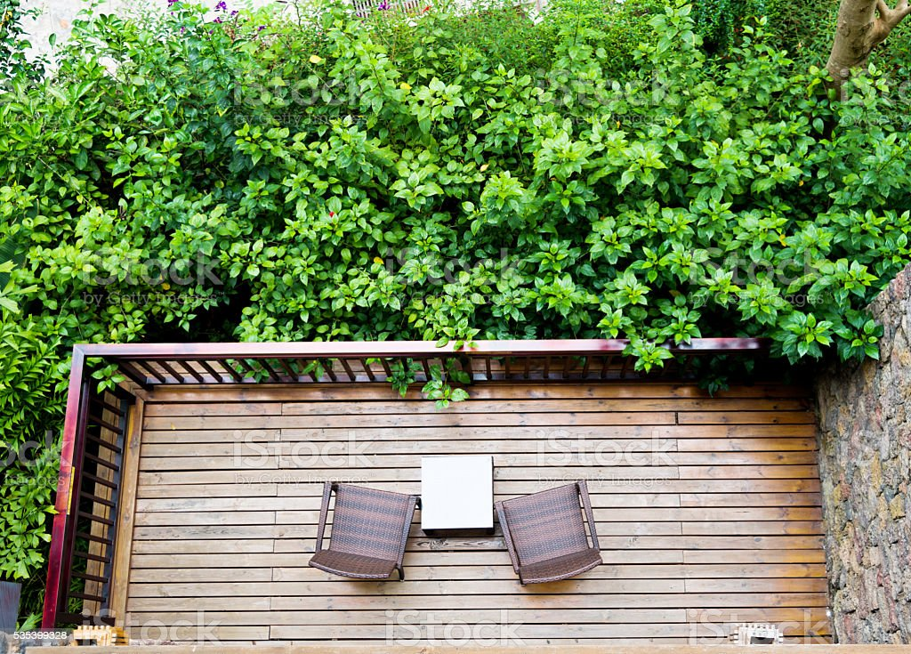 Two chairs in a balcony garden stock photo