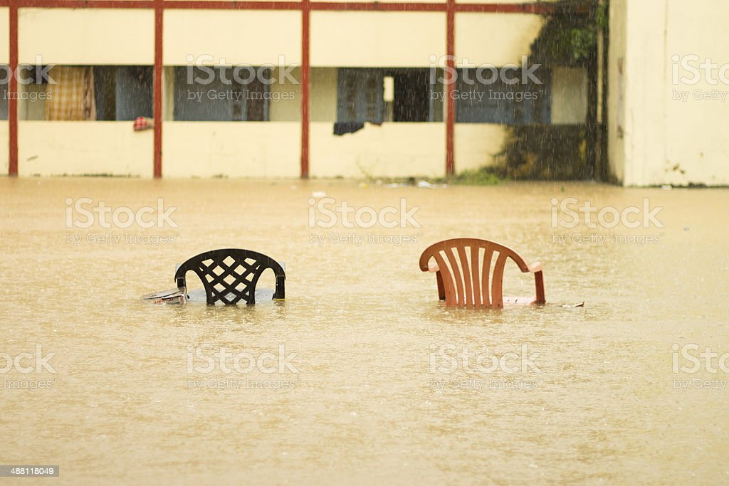 Two chairs in a flood. stock photo