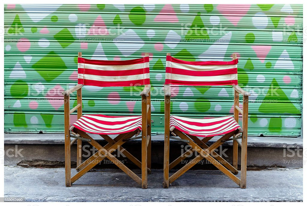 two chairs in front of a garage door royalty-free stock photo