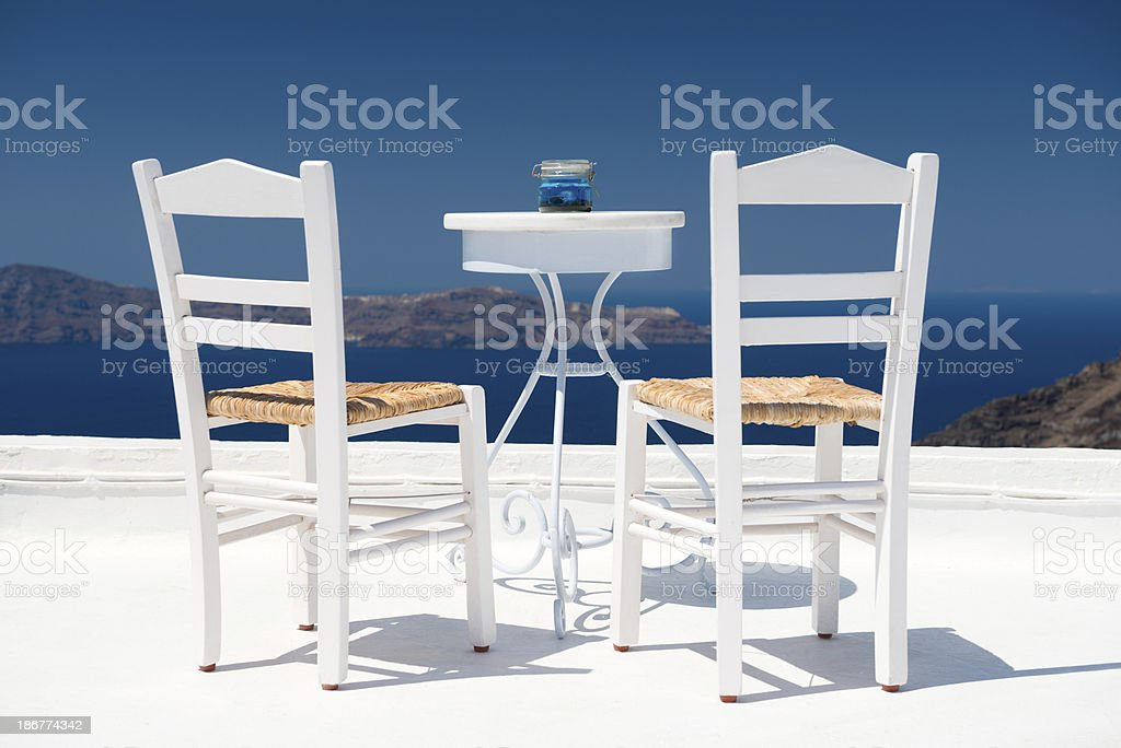 Two chairs on a Terrace, Santorini royalty-free stock photo