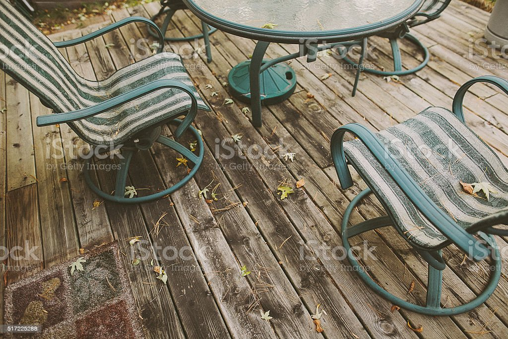 Two chairs on wooden porch at backyard in autumn stock photo