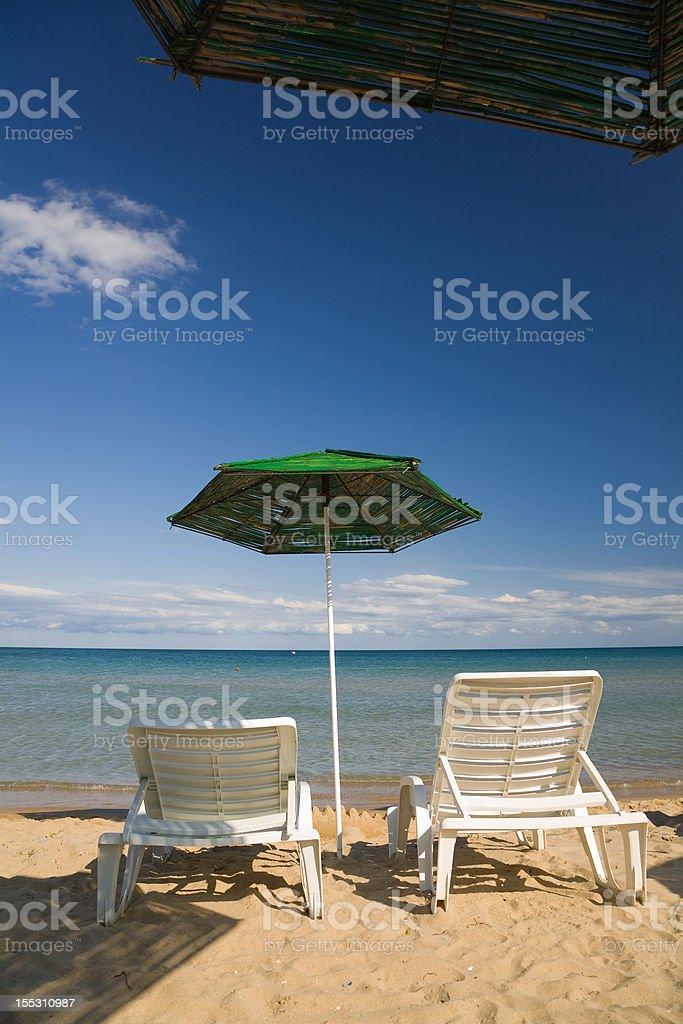 two chairs & umbrella stock photo