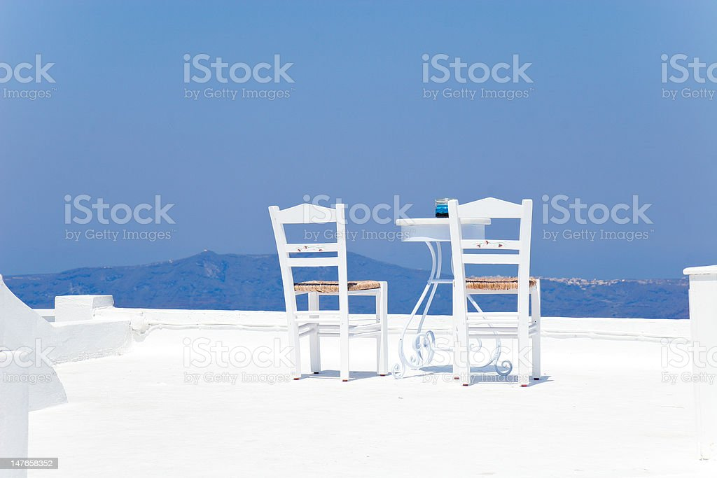 Two chairs with table on a terrace in the Mediterranean royalty-free stock photo