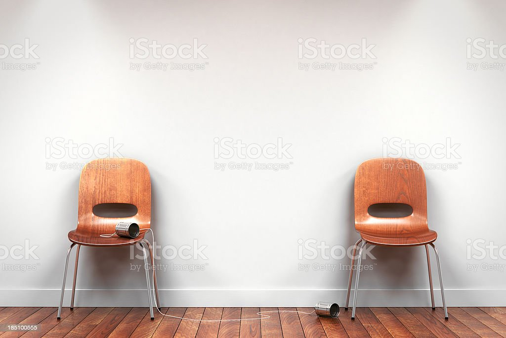 Two chairs with tin can phone stock photo