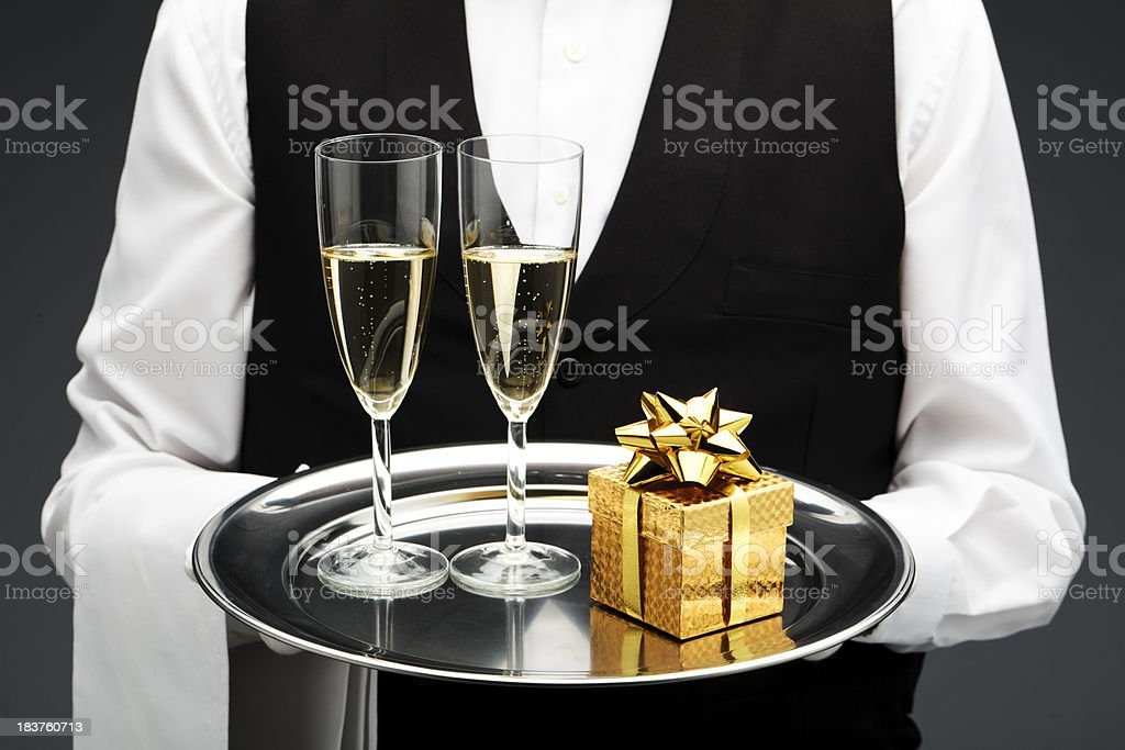two champagne flutes and gift stock photo