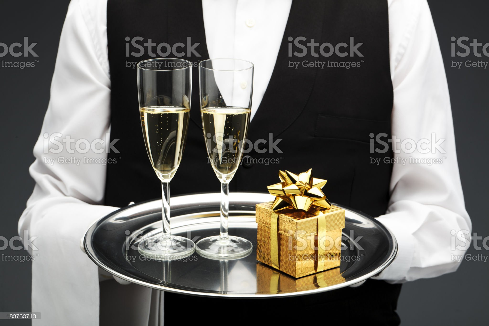 two champagne flutes and gift royalty-free stock photo