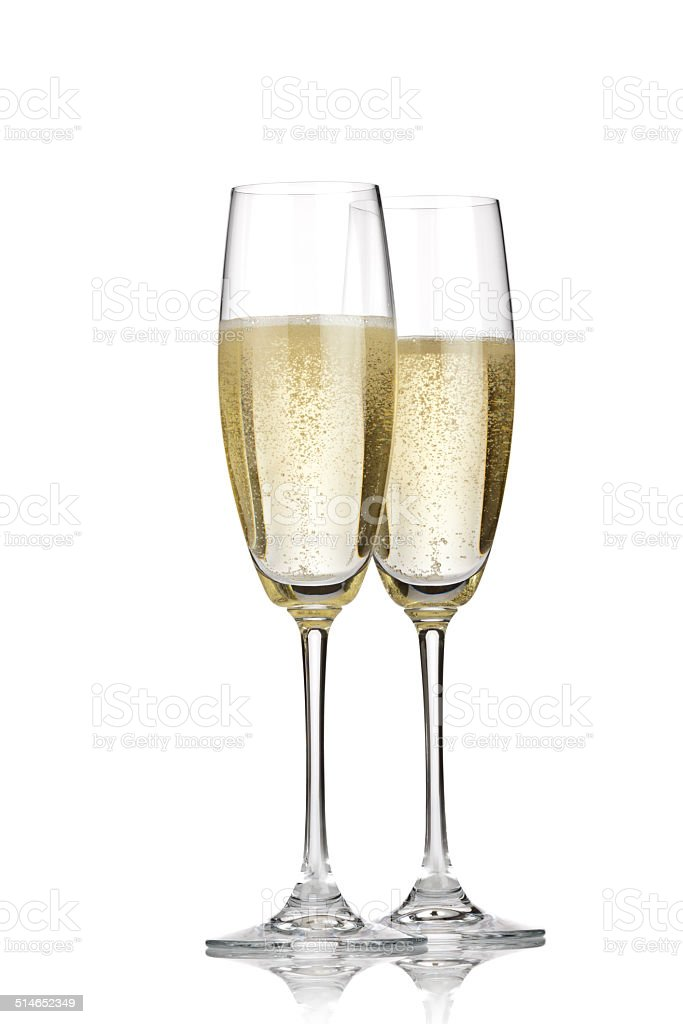 Two champagne flutes isolated on white backdrop stock photo