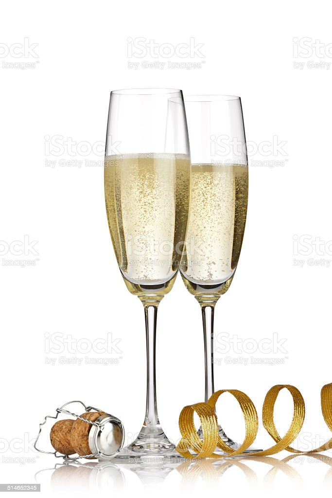 Two champagne flutes with golden ribbon and cork stock photo
