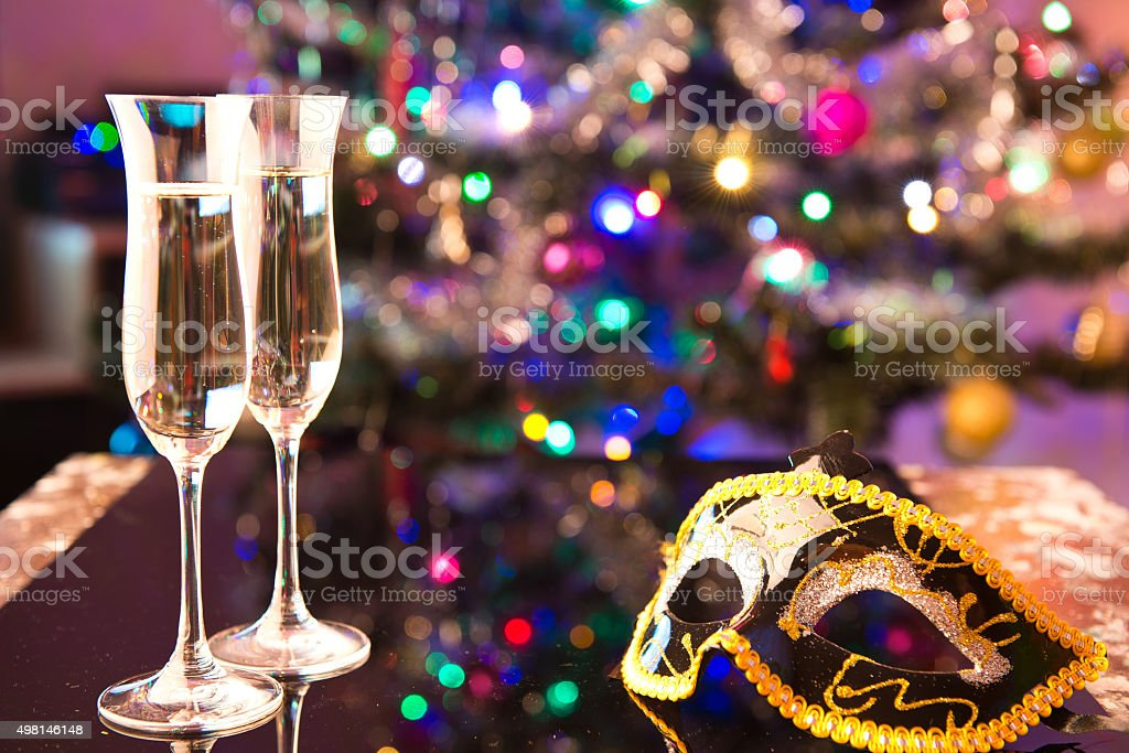 two champagne glasses and a mask stock photo