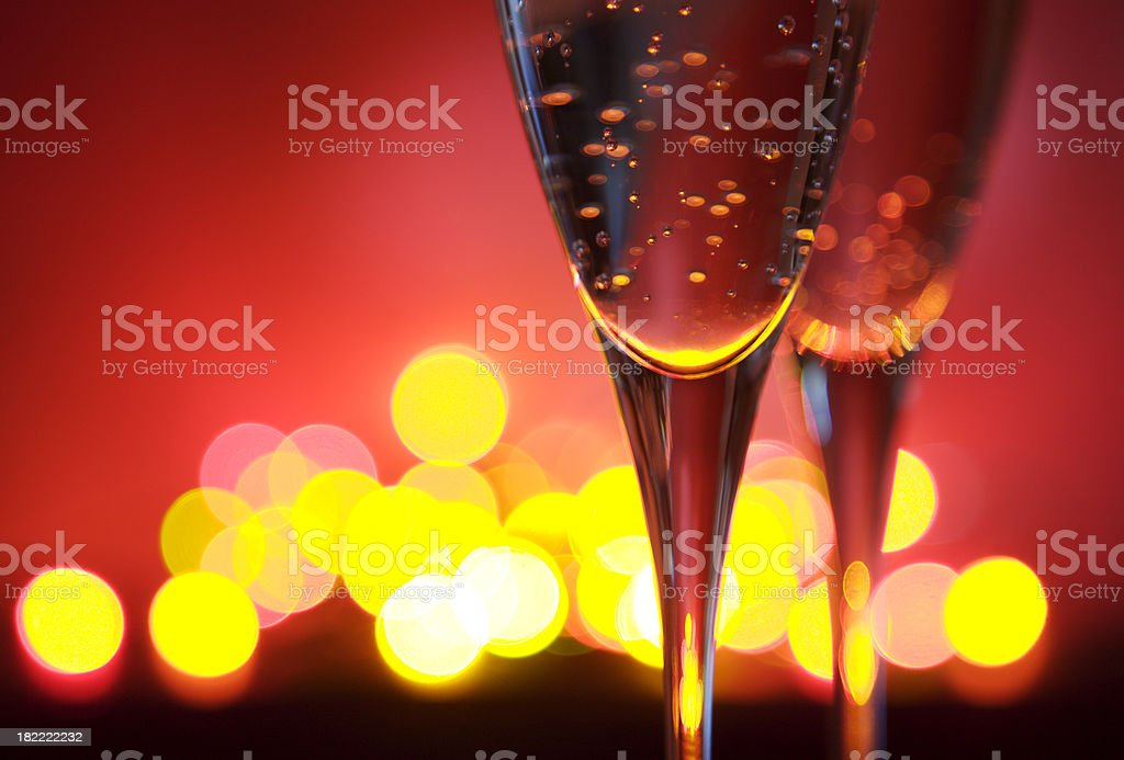 Two champagne glasses and defocused lights royalty-free stock photo