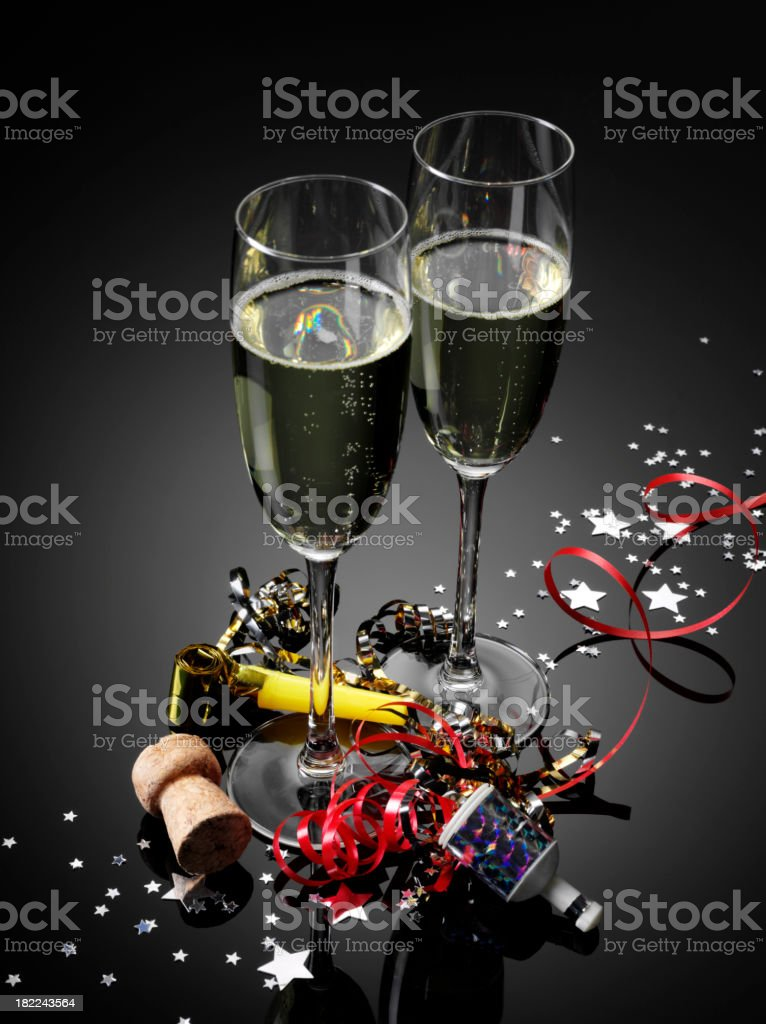 Two Champagne Glasses and Party Streamers royalty-free stock photo