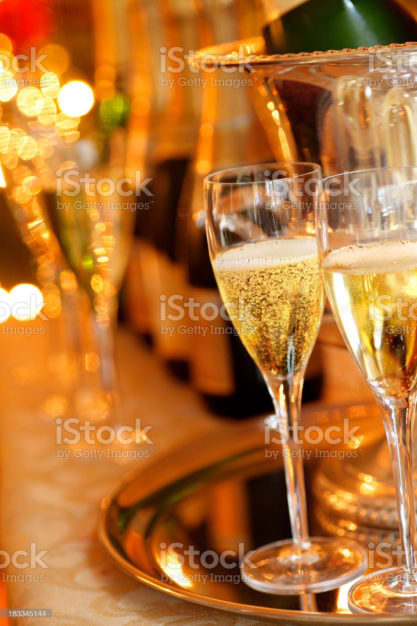 Two champagne glasses in holiday venue royalty-free stock photo
