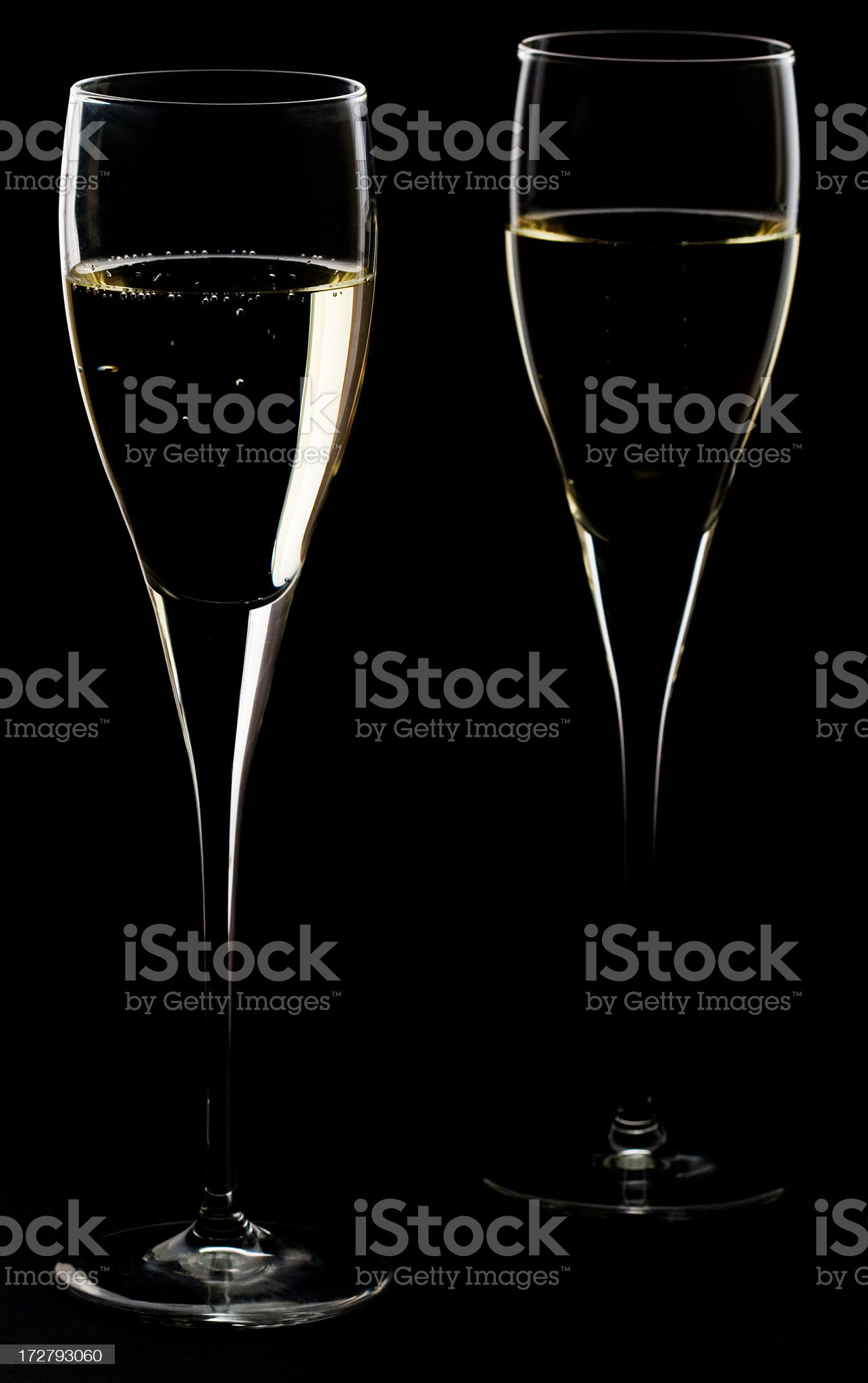 Two Champagne glasses on black background royalty-free stock photo