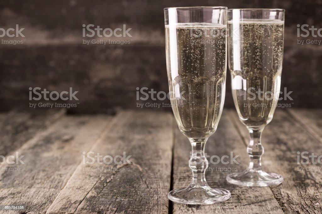 Two Champagne Glasses on wooden table stock photo