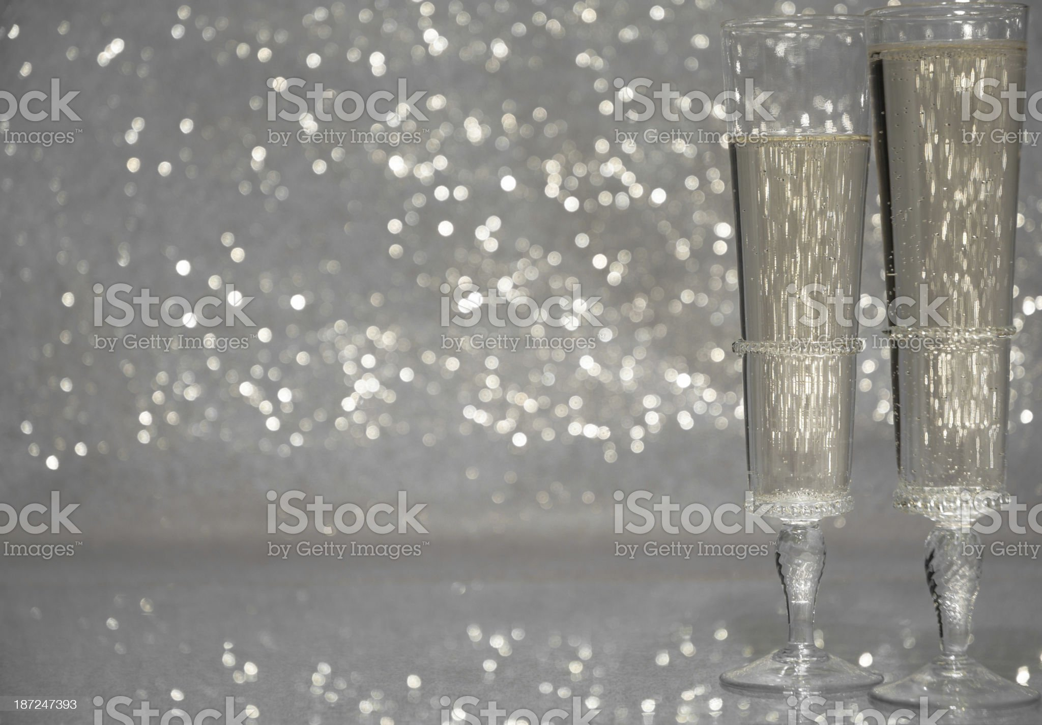 Two champagne glasses with sparkle background royalty-free stock photo