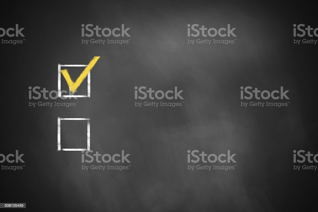two checkboxes on black chalkboard stock photo