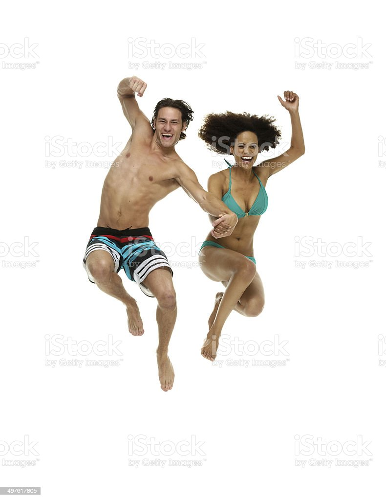 Two cheerful couple jumping royalty-free stock photo