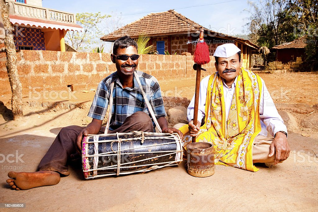 Two Cheerful Rural Indian Men with a traditional Music Instrument stock photo